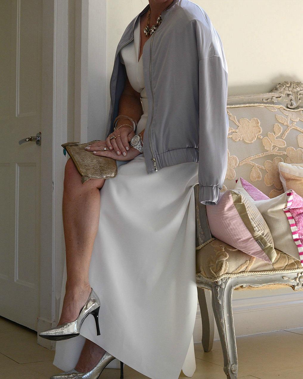 sara delaney wearing a maxmara summer evening dress with mango silver bomber jacket