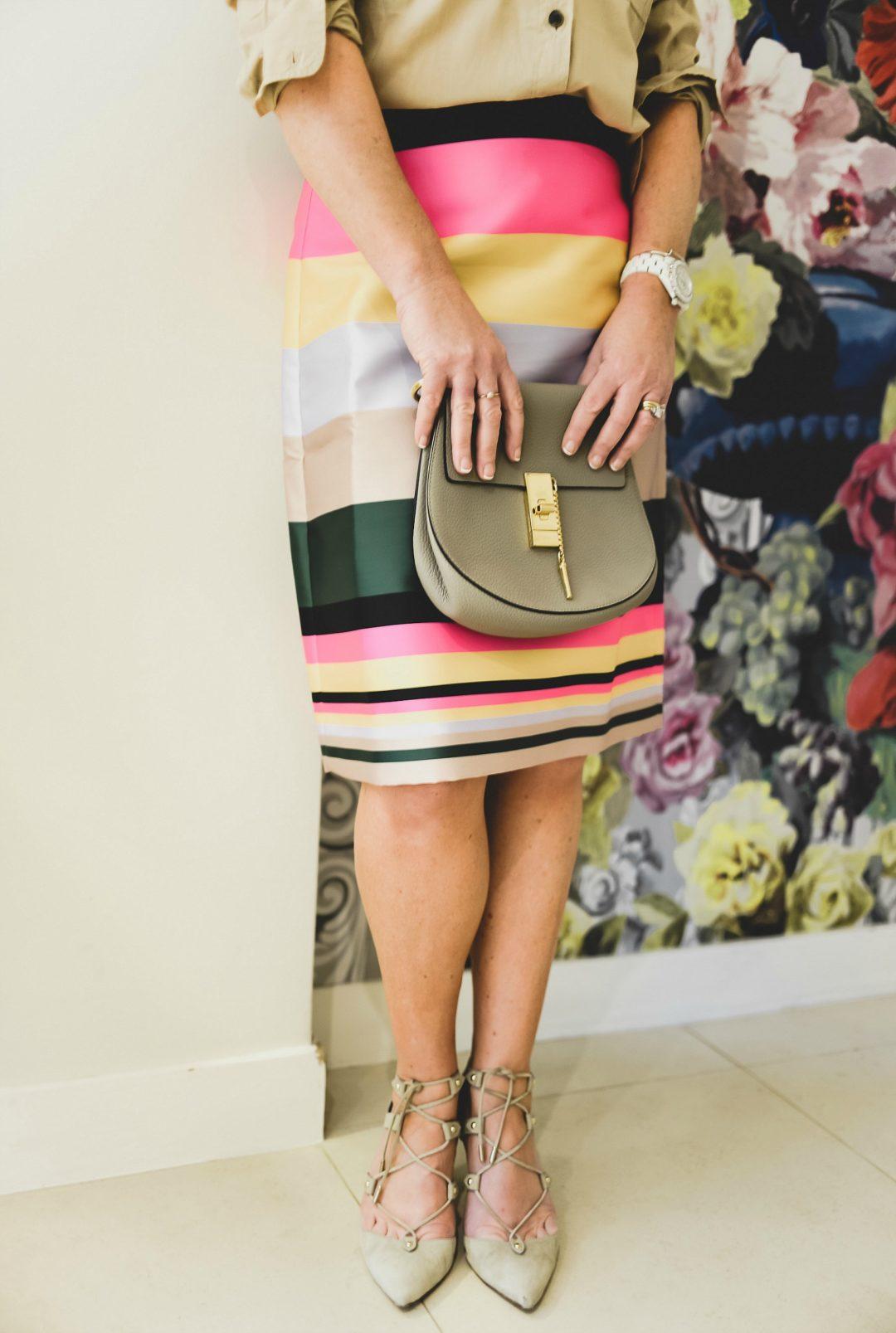 j.crew stripe skirt worn by stylist and fashion blogger sara delaney